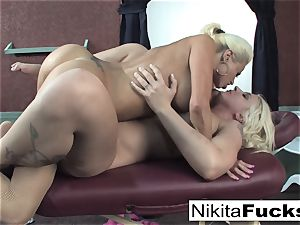 Nikita gets a relaxing rubdown from Leya