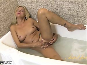 Payton Leigh bathes while playing with her labia