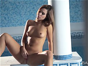 sandy-haired Jenny Appach milks by the pool alone