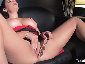 Naturally busty Taylor toys her moist coochie